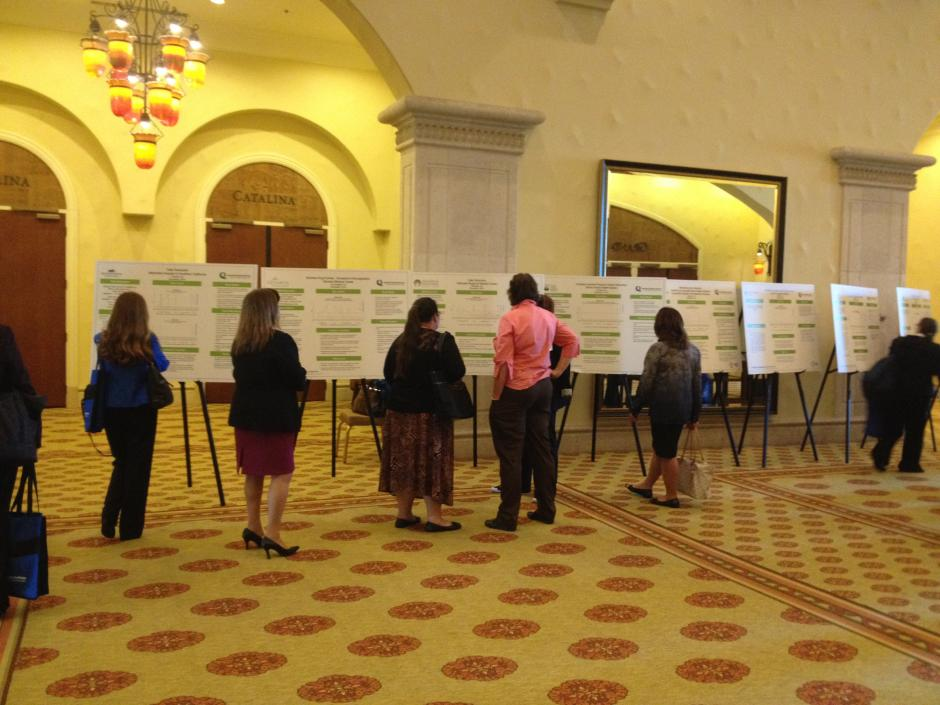 Accelerate Excellence attendees viewing poster exhibits | November 6, 2014 | Photo credit: Sholeh Varzegar